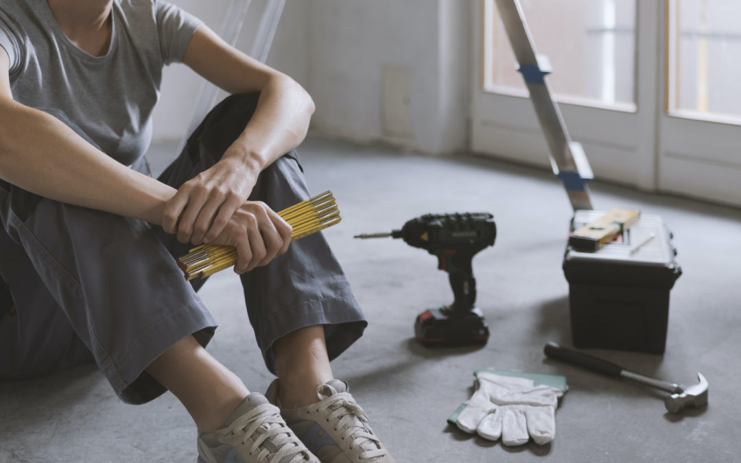 Woman on floor of house in middle of renovations